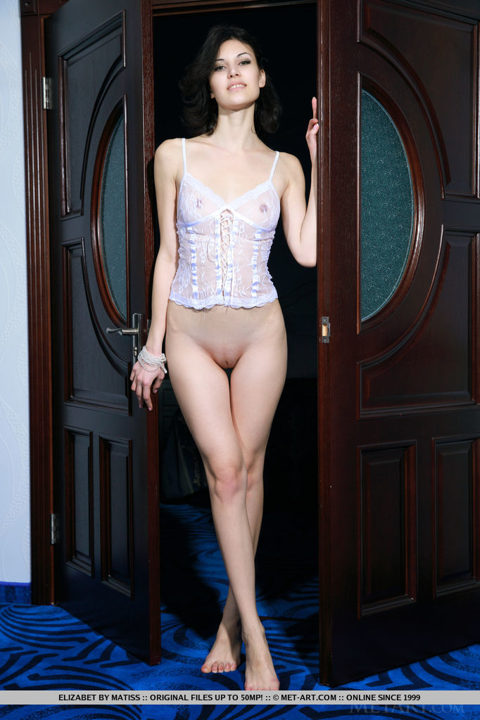 Sexy, confident, Elizabet looks stunning in a sheer white camisole that highlights her lean physique, perky pink nipples, and toned legs