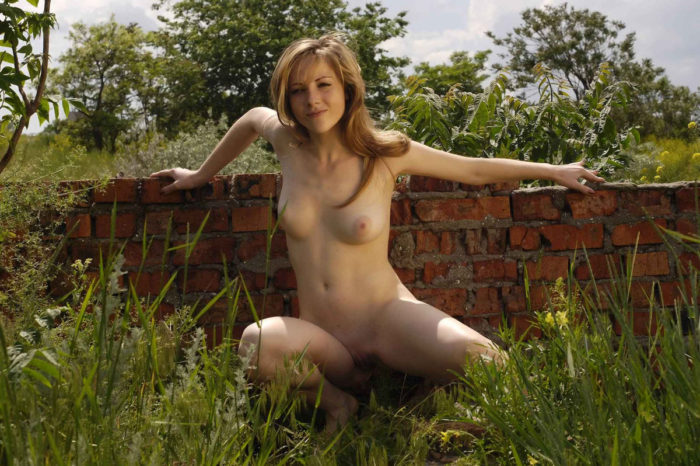 Sexy girl with nice soft boobs posing outdoors