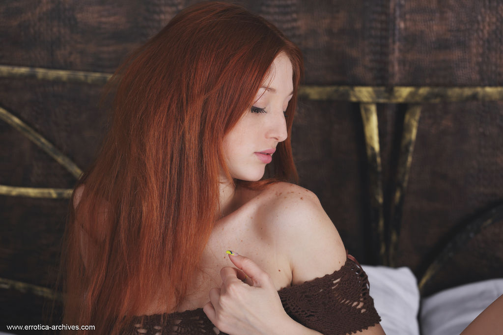 Sexy redhead Micca strips on the bed and shows off her amazing physique with delectable pussy in front of the camera.