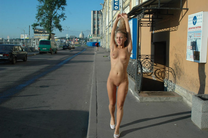 Shameless blonde with no clothes at streets