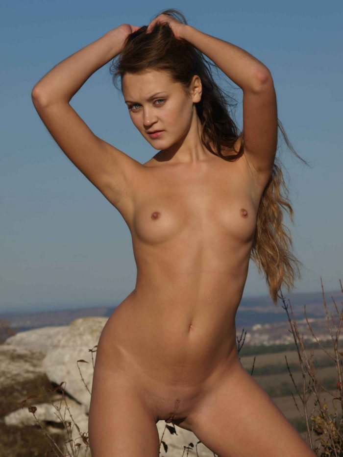 Tall girl Nataly R on top of a hill