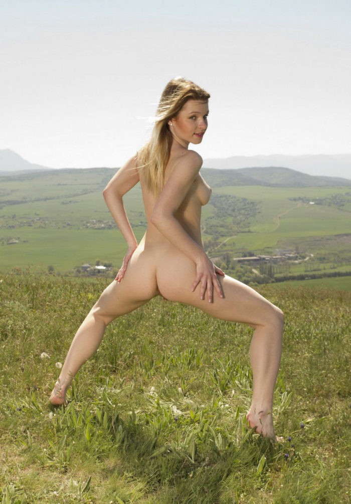 Teen busty blonde on the hill