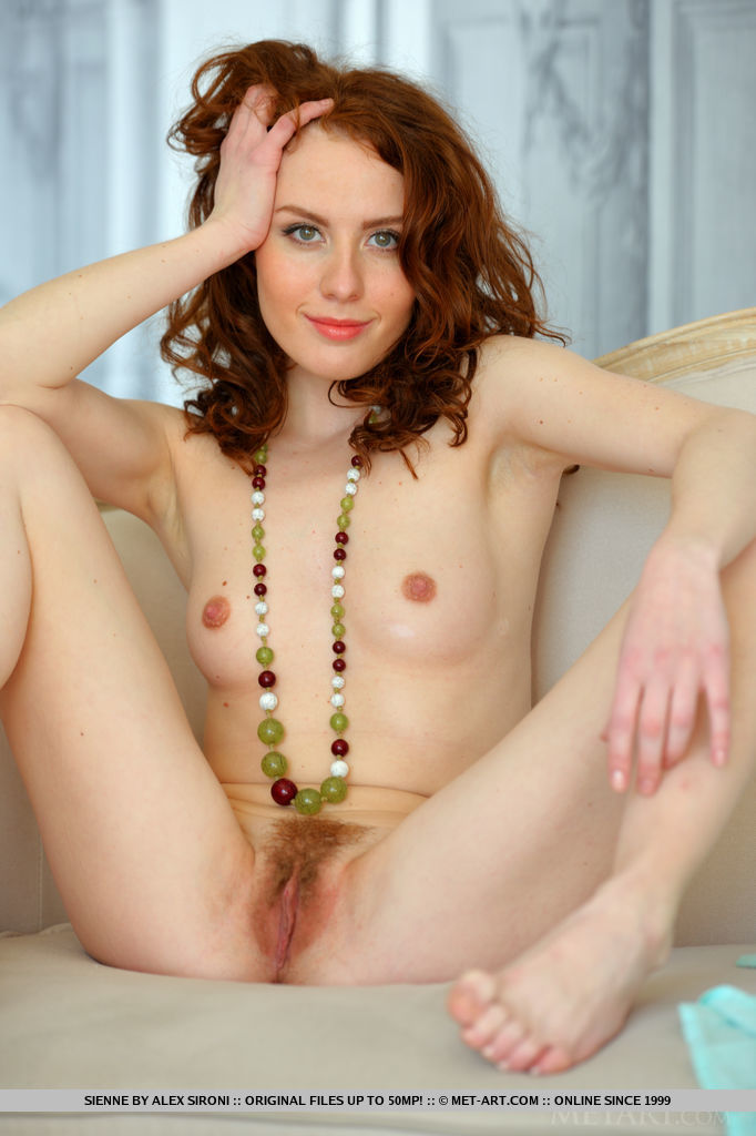 Wearing a sheer turquoise kaftan that compliments her red hair and smooth skin, Sienne is a sweetheart showing off her pink nipples and unshaved bush