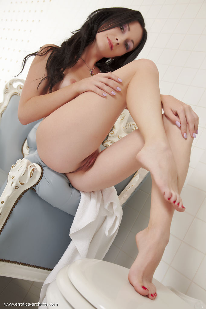 With a teasing look on her sultry face Night showcase her petite body with erotic and wide open poses.