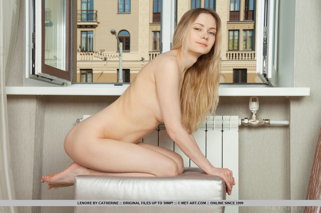 With a view of cityscape as her background, Lenore's feminine curves and delicate meaty assets take the centerstage