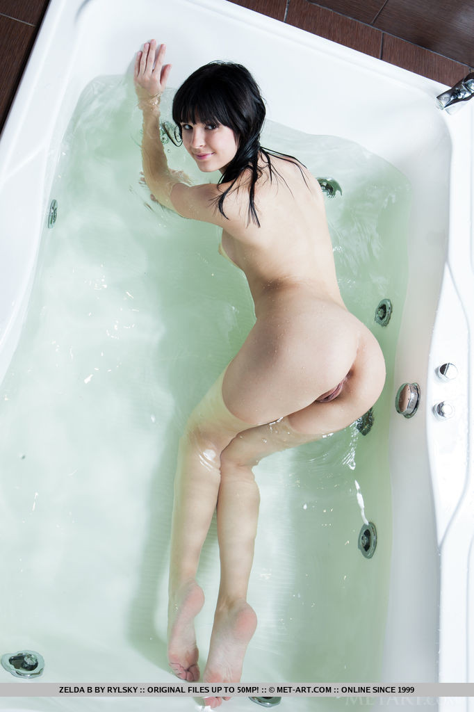 Zelda B shows off her curvy body, puffy breasts and yummy pussy by the bathtub.