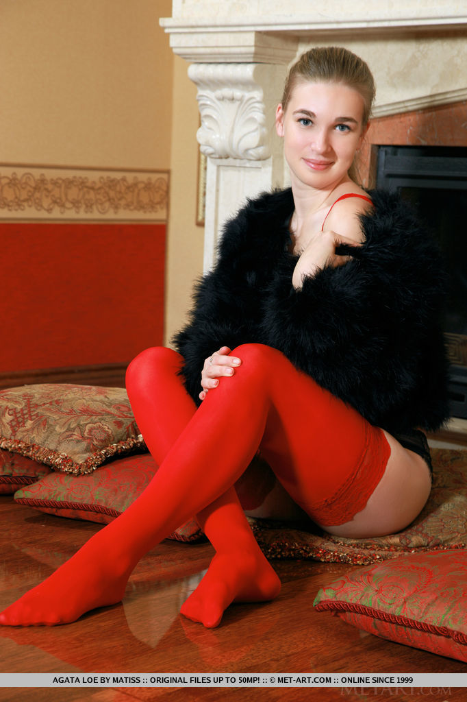 Agata Loe posing in red lace camisole and matching thigh-stockings that compliments her fair skin.
