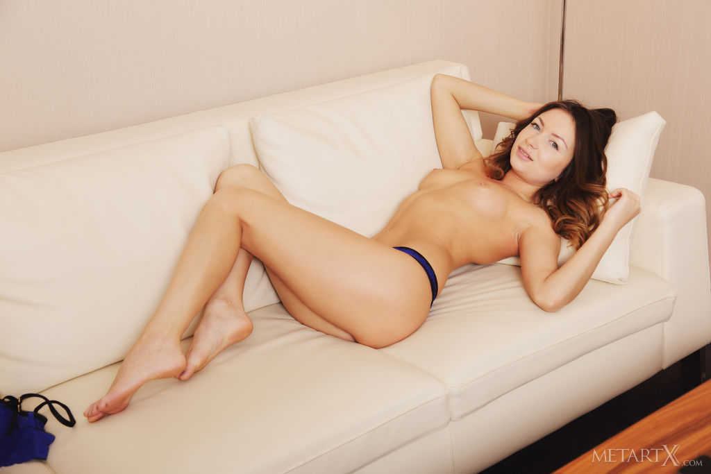 Alexa Day in a matching royal blue brassiere and panties, seducing and tempting with her luscious body