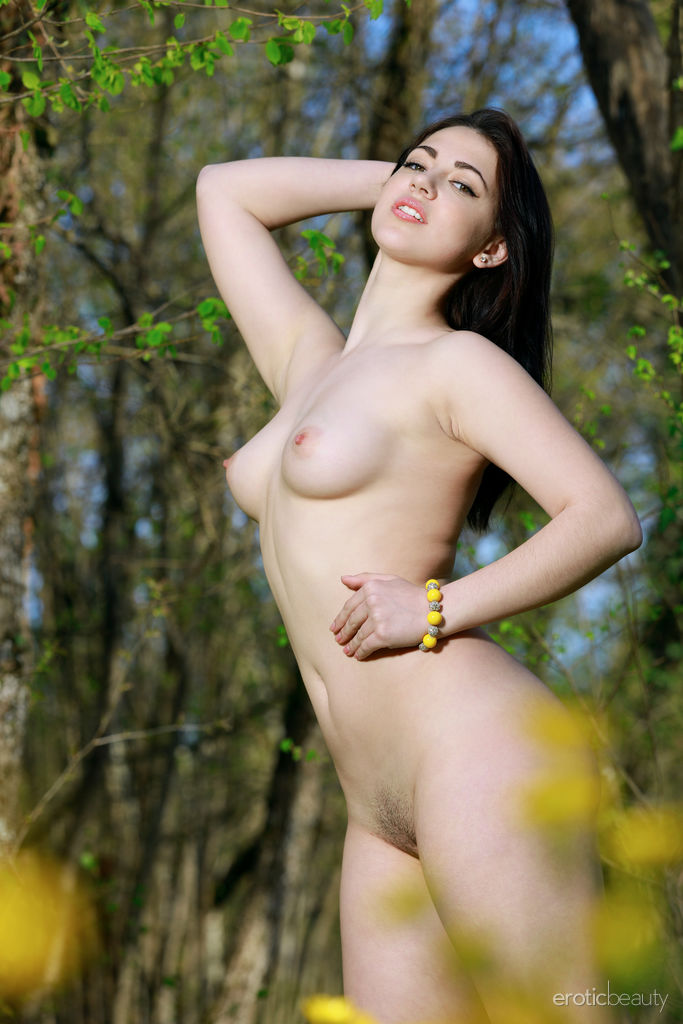 Alluring Sivilla flaunts her beautiful body in the meadows.