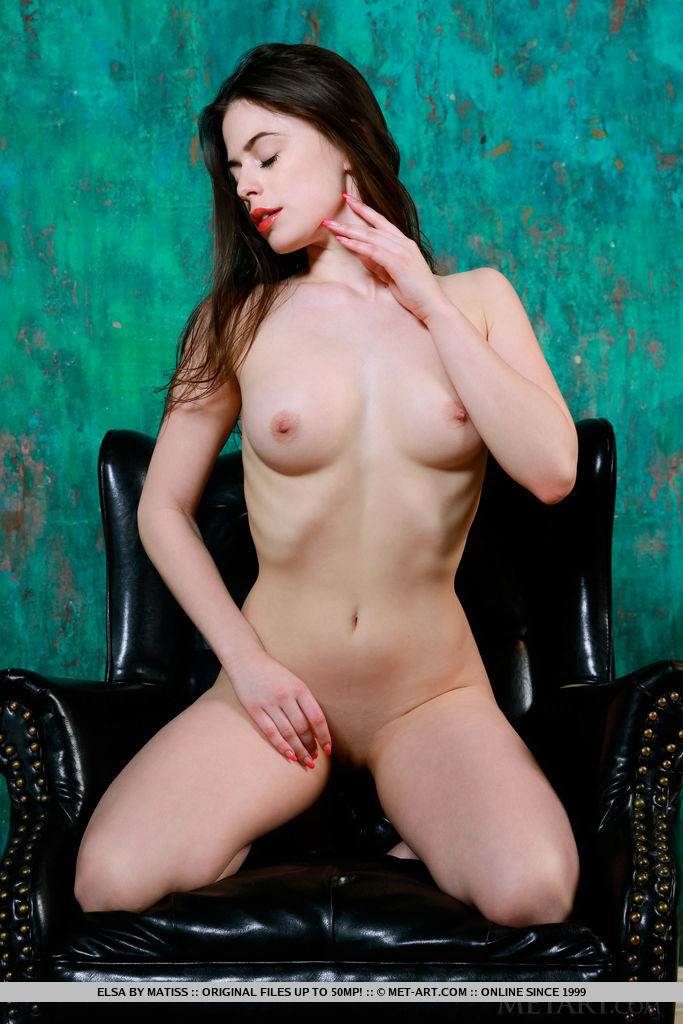 Elsa shows off her erect, pink nipples and delectable pussy on the chair.