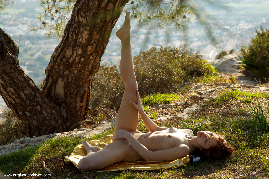 Emanuelle bares her creamy body, pink nipples and sweet pussy outdoors.
