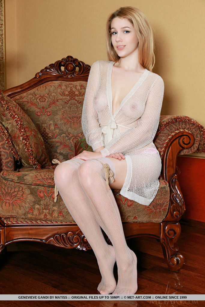 Genevieve Gandi bares her creamy, white body and pink pussy on the chair.