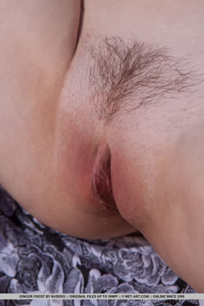 Ginger Frost strips by the beach baring her trimmed, pink pussy.