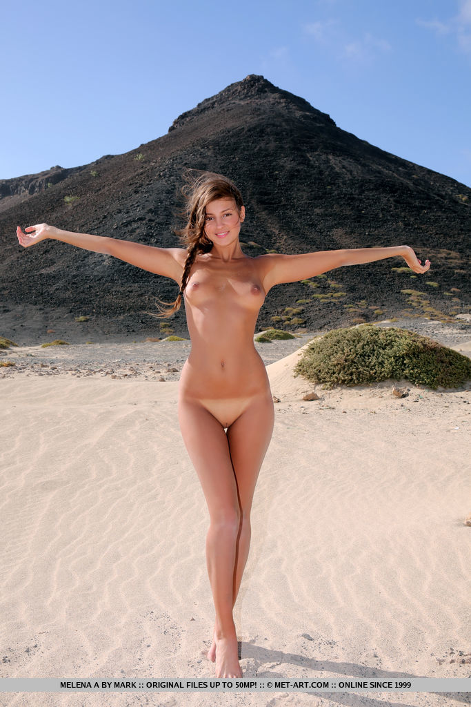 Melena A displays her sexy, tanned body and smooth pussy at the beach.