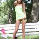 Melena A strips outdoors baring her sexy, tanned body.