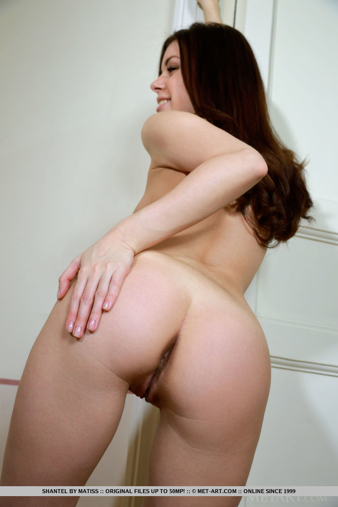 New model Shantel bares her meay ass and sweet pussy on the floor.