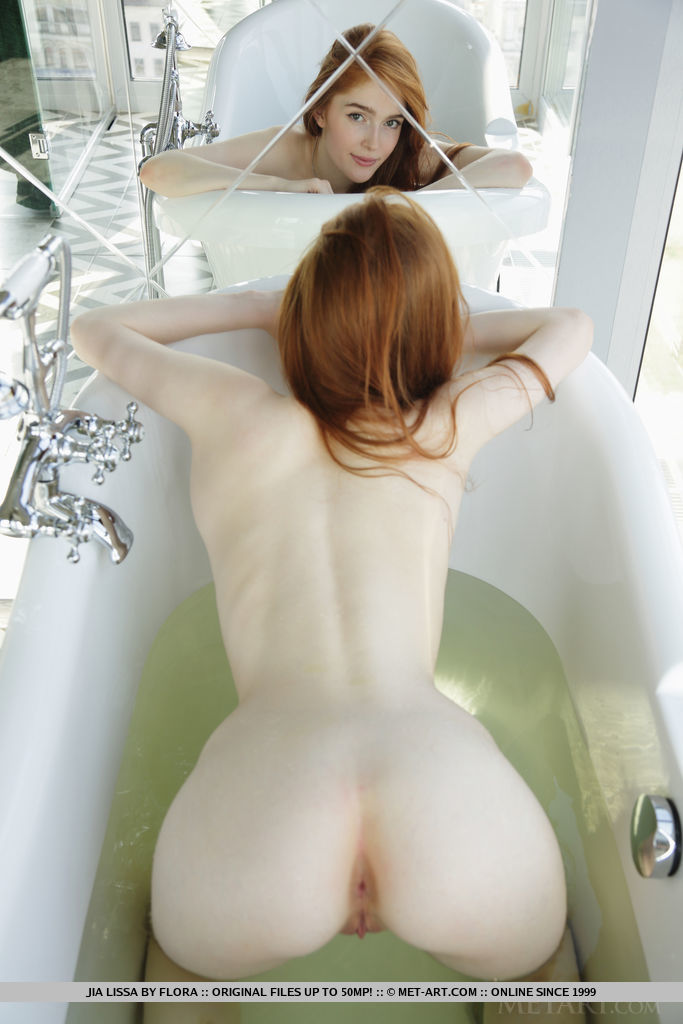 Newcomer Jia Lissa dips in the bathtub baring her wet, tight body.