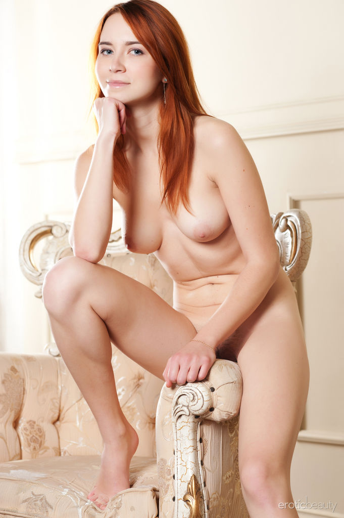 Newcomer Kelly G bares her beautiful tits and trimmed pussy on the chair.
