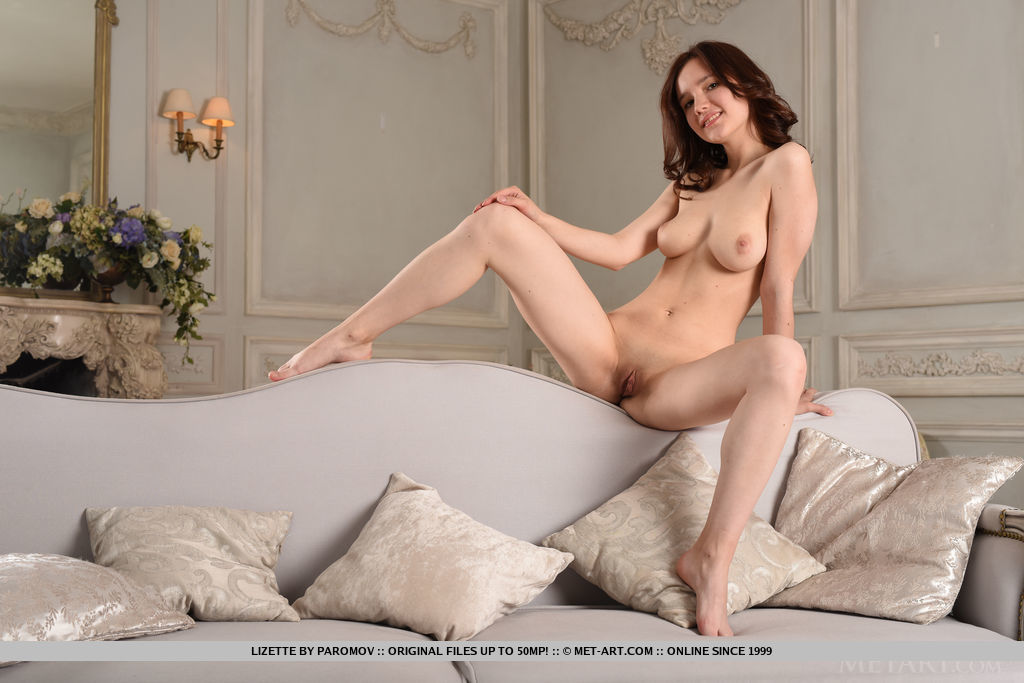 Newcomer Lizette flaunts her creamy, slender body and sweet pussy on the couch.
