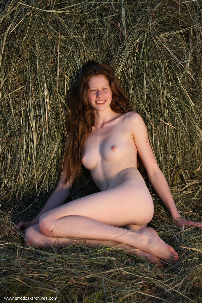 Nicole K poses on the grass field as she flaunts her creamy, slender body.