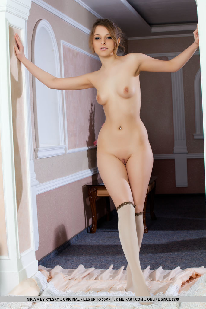 Nikia A flaunts her amazing, nubile body as she poses on the couch.