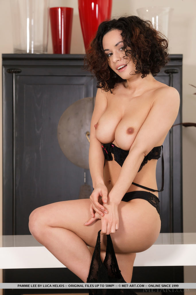 Pammie Lee strips on the table baring her beautiful tits and delectable pussy.