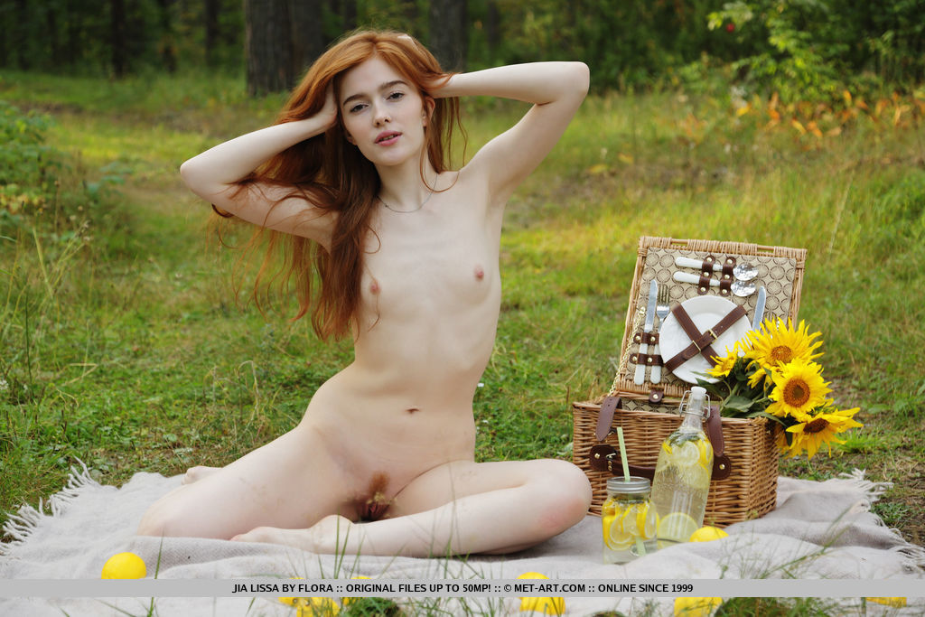 Redhead Jia Lissa strips outdoors as she displays her trimmed pussy.