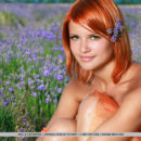 Redhead Violla A bares her sexy, tanned body and smooth pussy in the meadows.