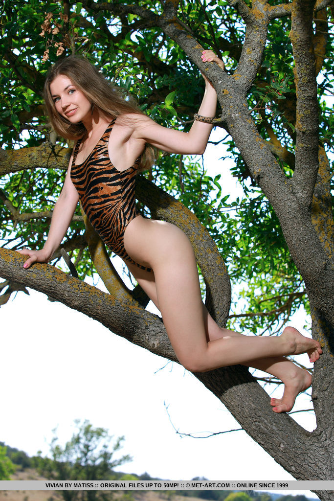 Vivian flaunts her slender body and sweet ass outdoors.