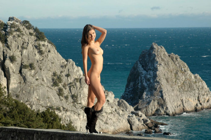 A female with an perfect figure on a mountain road