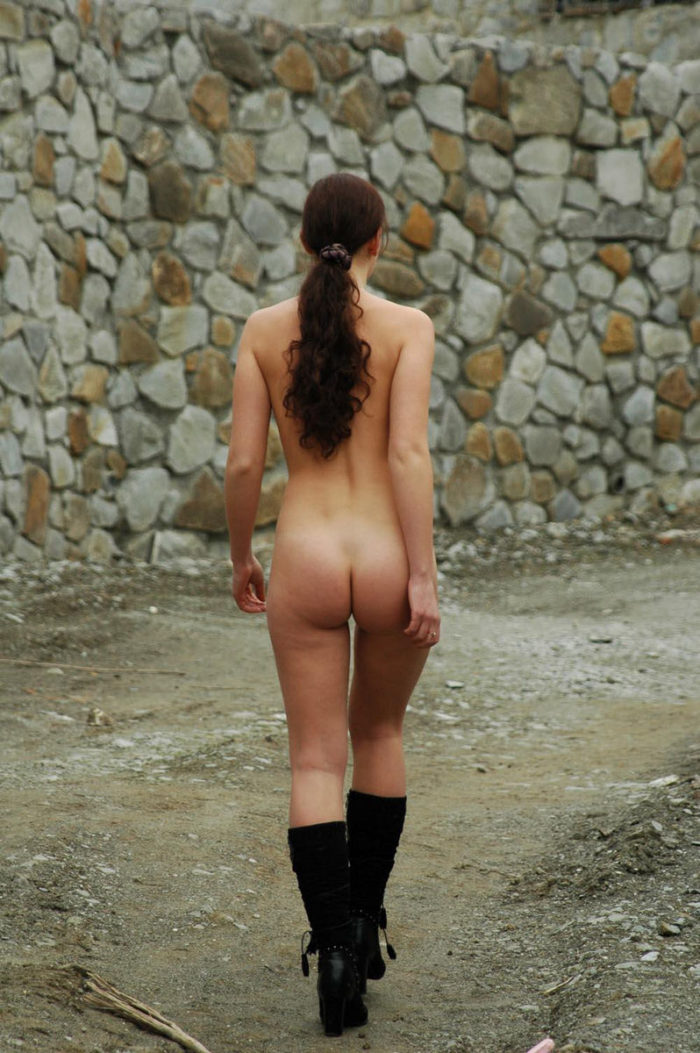 A girl in boots in a mountain village