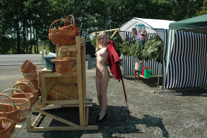Absolutely naked blonde at road market