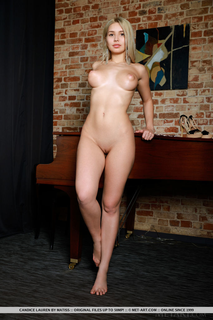 Alluring blonde Candice Lauren shows off her big tits and smooth pussy on the piano.