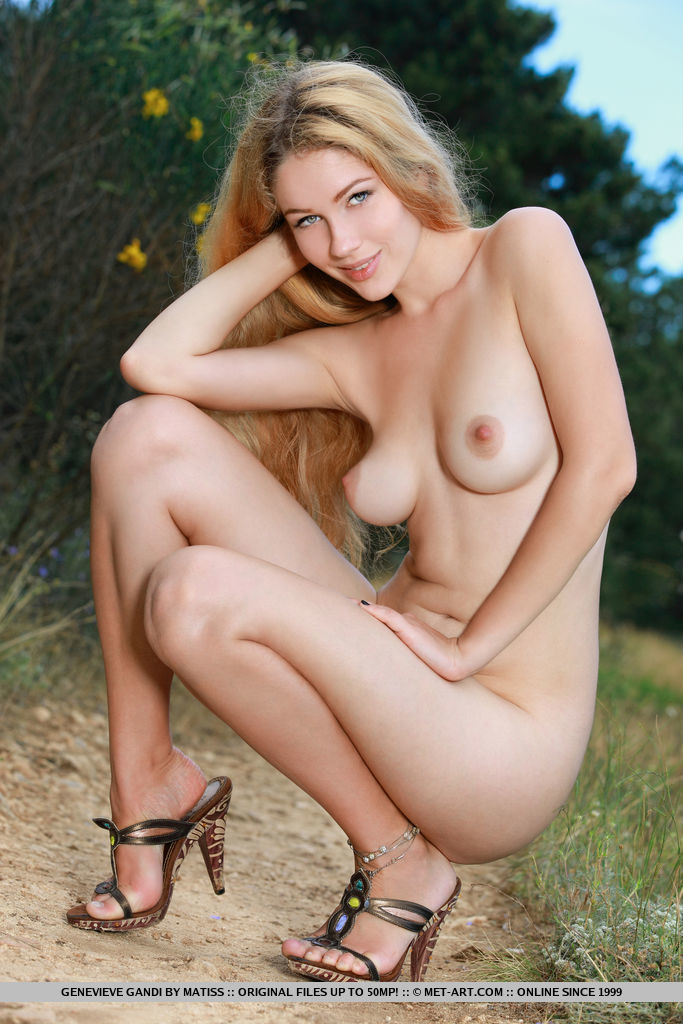 Beautiful Genevieve Gandi shows off her delectable, creamy body outdoors.