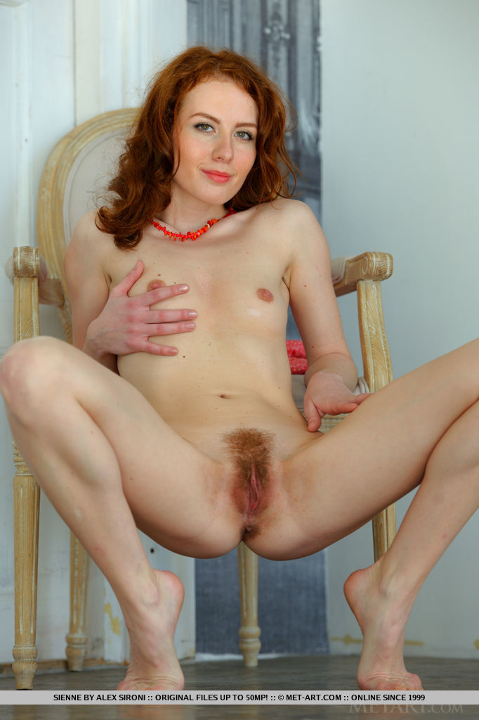 Beautiful Sienne, shows off her creamy white body with pink nipples and yummy unshaven pussy on the chair.