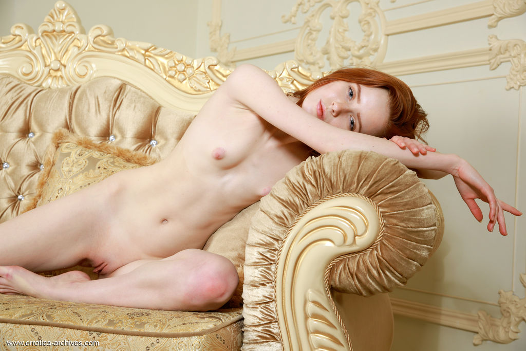 Bella Milano flaunts her petite, creamy body and pink pussy on the couch.