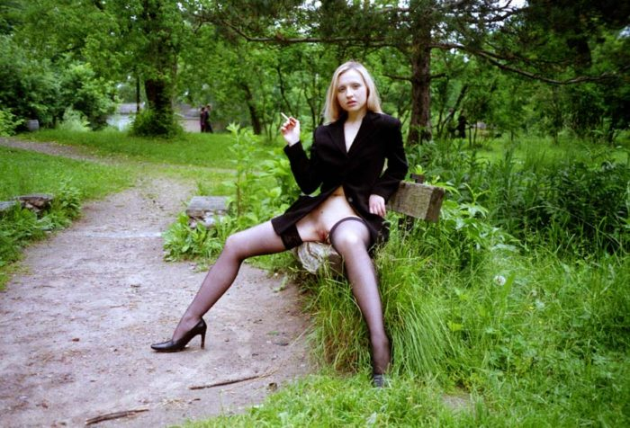 Blonde Elza smokes cigarette with spreads legs on the bench