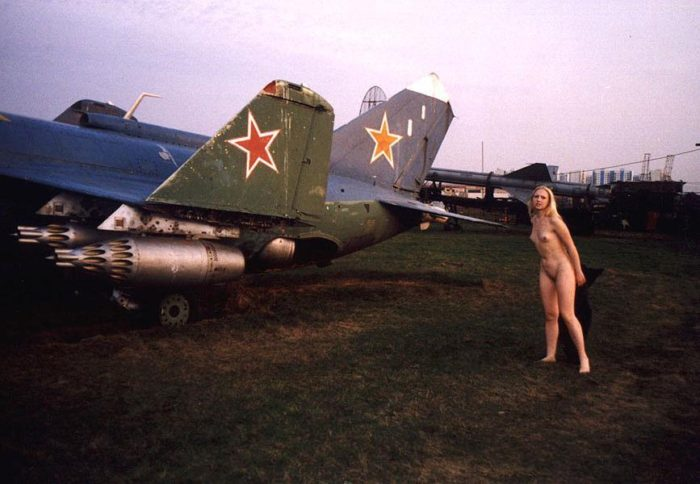 Blonde Elza with no clothes at airplane museum