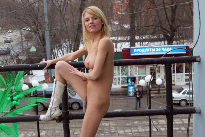 Blonde in white boots spreads legs on the streets