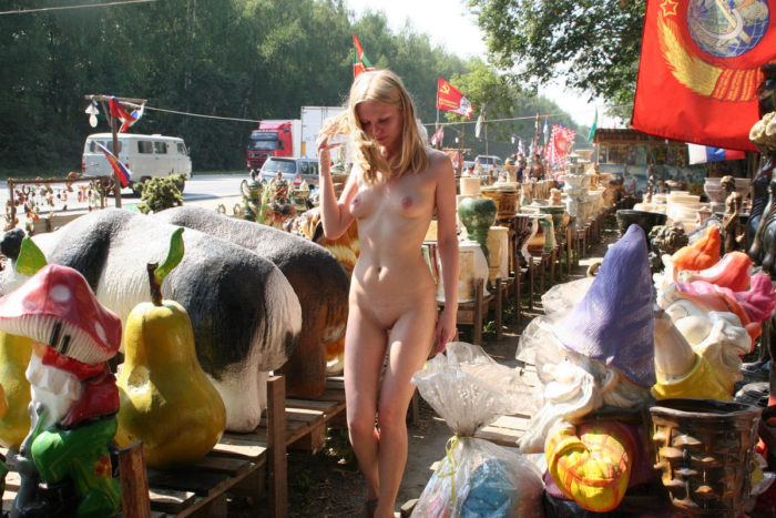 Blonde with slender body walks naked at market