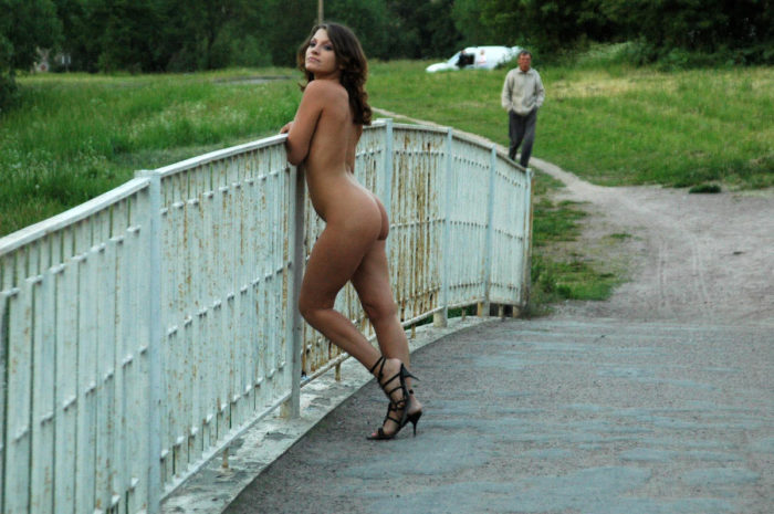 Girl in black shoes on a small bridge
