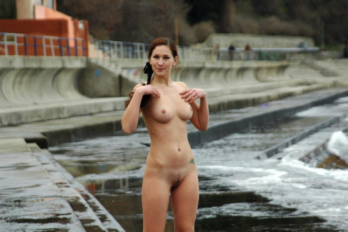 Huge-titted babe with a pigtail on the coast