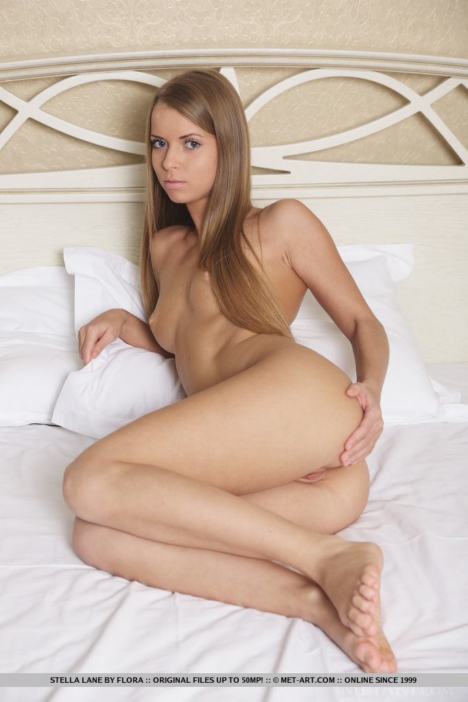 Izabel A shows off her youthful beauty and nubile body clad in matching lavender lingerie.