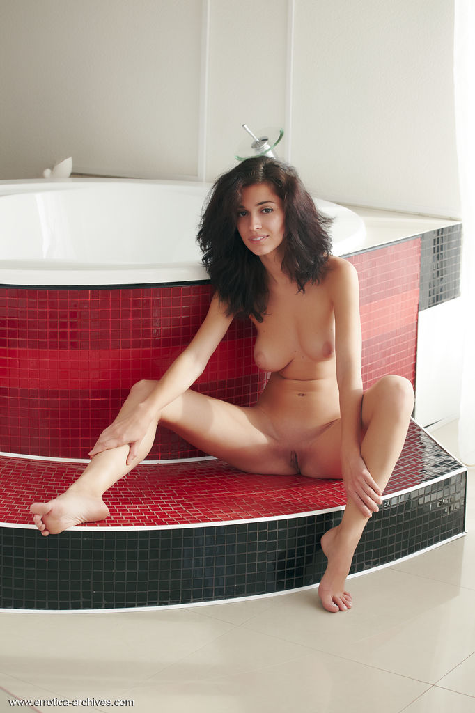 Karen showcases her gorgeous, naked body with puffy breasts and delectable pink pussy as she poses in the bathroom.