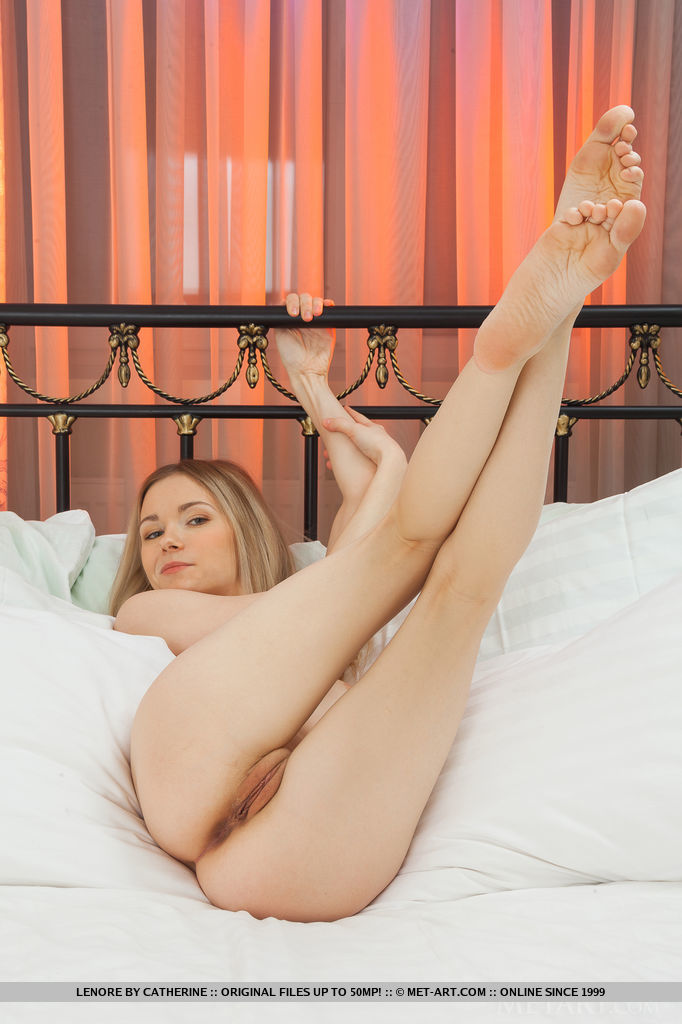 Lenore looks delicately enticing in sheer pink nighties as she sprawl on top of the bed