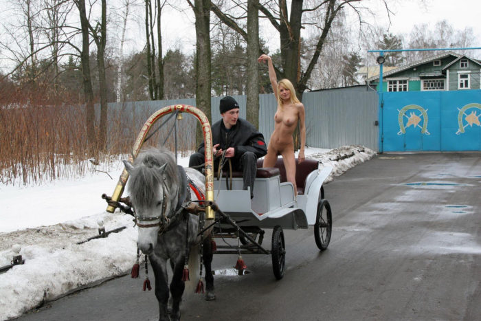 Lovely blonde Uliana A is riding on a horse cart (naked)