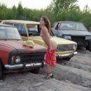 Naked girl Oksana E in the dump of old cars