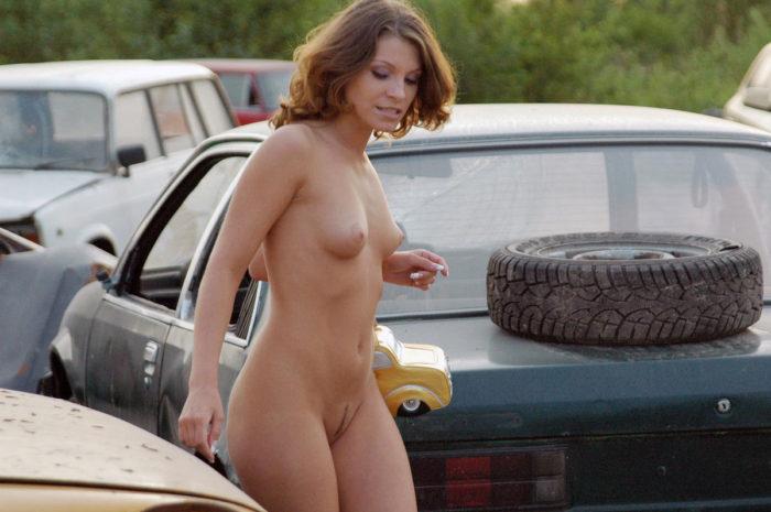 Naked girl Oksana E in the dump of old cars
