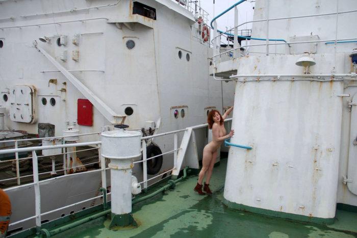 Naked redhead girl Masha on big ship