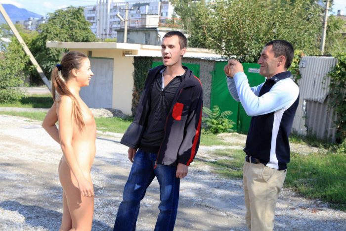 Naked teen Taissia A posing with strangers at street